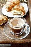 Cappuccino in Transparent Cup and Croissants Stock Photography