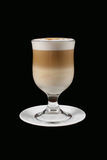 Cappuccino in transparent glass on black background. The cappuccino in transparent glass on black background Royalty Free Stock Photography