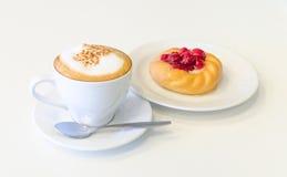 Cappuccino und Bonbon Stockfotos