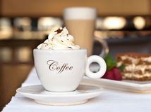 Cappuccino with whipped cream Stock Photos