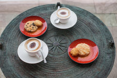 Cappuccino in white circles with cookies. Royalty Free Stock Photo