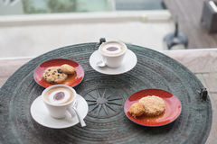 Cappuccino in white circles with cookies. Stock Photos