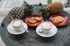 Cappuccino in white circles with cookies. Royalty Free Stock Image