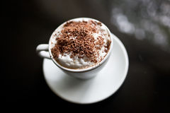 Cappuccino in white cup with chocolate sprinkles Royalty Free Stock Images