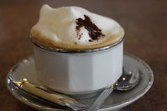 Cappuccino. White cup of cappuccino with milk foam in close-up Stock Images