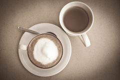 Cappuccino in white cup and tea. Stock Photos