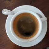 Cappuccino on the wood table. Royalty Free Stock Photography