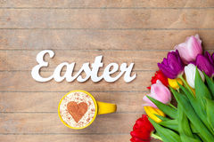 Cappuccino  and word Easter near flowers Royalty Free Stock Photo