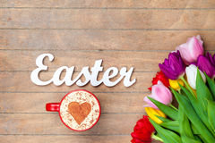 Cappuccino  and word Easter near flowers Stock Photos