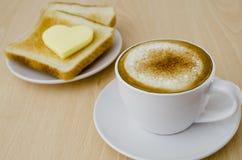 Cappuccino zum Frühstück Stockbild