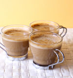 Cappuccinos. Coffee time - three cappuccinos, close-up stock photos