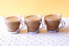 Cappuccinos. Coffee time - three cappuccinos, close-up stock photo