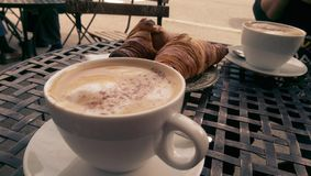 Cappuccinos and croissants Royalty Free Stock Photo
