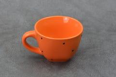 Cappuccio arancio isolato su fondo grigio Fotografia Stock Libera da Diritti