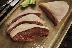 Cappuccio della groppa - bistecca cruda - barbecue Immagini Stock Libere da Diritti