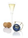 Cappuccio di Champagne con l'iscrizione 50 anni Fotografia Stock Libera da Diritti