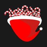 Cappuccio e bastoncino di zucchero di Santa Bastone della menta di Natale Cappello di rosso di natale Immagini Stock