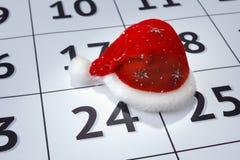 Cappuccio e calendario di Santa Claus Fotografia Stock Libera da Diritti