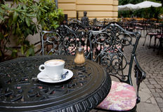 Cappuchino in a cafe outdoors. A cappuchino, served on an outdoor table, nobody royalty free stock photography