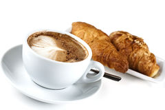 Cappuchino With Croissant. Isolated in studio. Shallow d o f Stock Photo