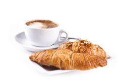 Cappuchino With Croissant. Isolated in studio. Shallow d o f Stock Photos