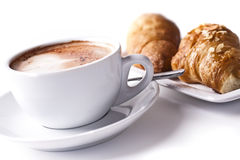 Cappuchino With Croissant. Isolated in studio. Shallow d o f Royalty Free Stock Image