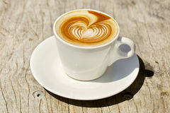 Cappuchino or latte coffe in a white cup with Royalty Free Stock Photography
