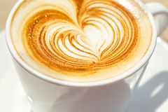 Cappuchino or latte coffe in a white cup with Stock Images