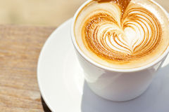 Cappuchino or latte coffe in a white cup with Royalty Free Stock Photo