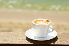 Cappuchino or latte coffe in a white cup with Stock Photo