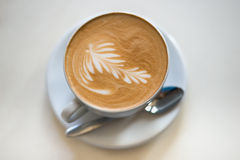 Cappuchino or latte coffe in a white cup on a light background Stock Photo