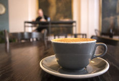 Cappuchino on a table. Royalty Free Stock Photo