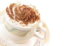 Cappucino. Cup of cappuccino coffee isolated on white royalty free stock image
