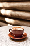 Cappucino in a brown cup Stock Image