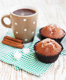 Cappucino and chocolate muffins. Cup of fresh cappucino and chocolate muffins stock image