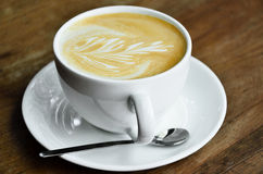 Cappucino coffee cup. On wooden table stock photo