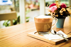 Cappucino coffee on wood table Royalty Free Stock Photo