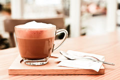 Cappucino coffee on wood table Royalty Free Stock Photography