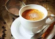 Cappucino Cup Coffee. Cup of Cappucino Coffee with Coffee Beans and a Cinnamon Stick royalty free stock image