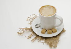 Cappucino with dark sugar. Isolated on white background Stock Photography