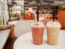 Cappucino Frappe and Frappuccino on white table. At coffee shop stock image