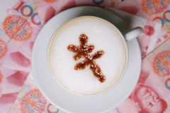 Cappucino with RMB sign. Cup of cappucino with RMB sign on money(RMB Stock Photography