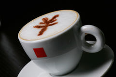 Cappucino with RMB sign. Cup of cappucino with RMB sign Stock Photo