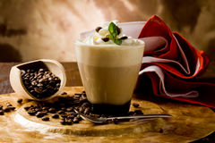 Cappucino with whipped cream. Photo of delicious coffee beverage with whipped cream and coffee beans stock photography