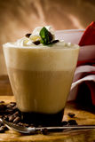 Cappucino with whipped cream. Photo of delicious coffee beverage with whipped cream and coffee beans royalty free stock photo