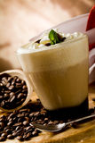 Cappucino with whipped cream. Photo of delicious coffee beverage with whipped cream and coffee beans stock photo