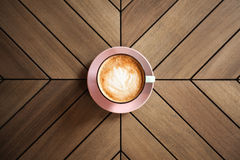 Cappucino on wooden table Stock Photography