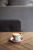 Cappucino on wooden table Royalty Free Stock Photo