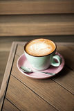 Cappucino on wooden table Stock Image
