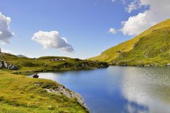 Blue mirror lake and blue sky in the mountains Royalty Free Stock Photo